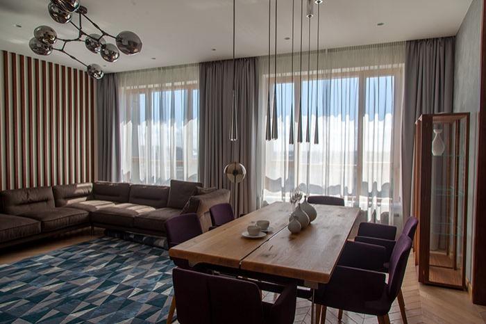 Современный декор гостиной в серо-голубых тонах.